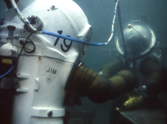 Two JIM suit divers in the tank at HMNB Rosyth